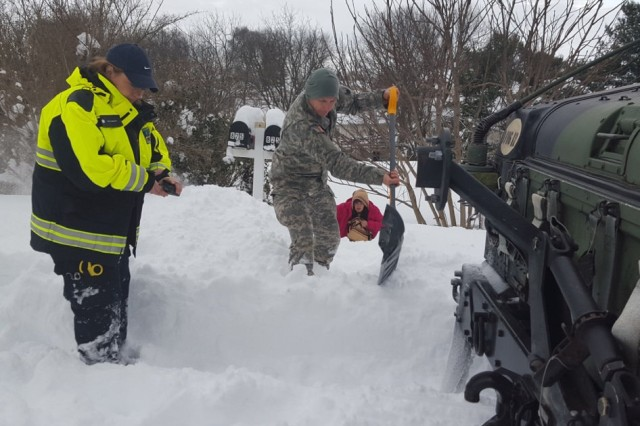 Virginia National Guard Soldiers, assigned to the Pulaski-based Company D, 1st Battalion, 116th Infantry, 116th Infantry Brigade Combat Team, assist the Waynesboro First Aid Crew with a rescue call, Jan. 23, 2016, near Waynesboro, Va.