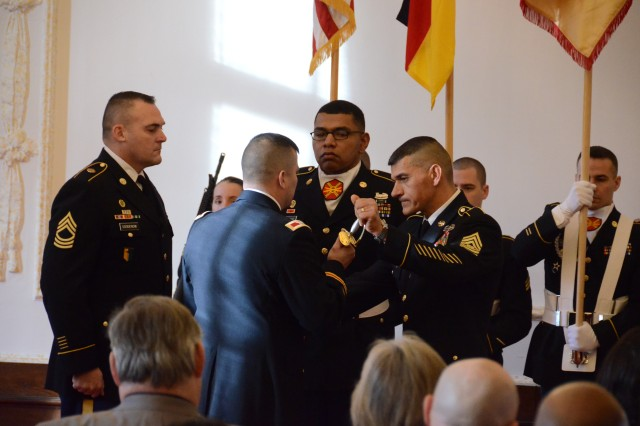 ANSBACH, Germany (Jan. 26, 2016) -- Command Sgt. Maj. Kiefer, center right, senior noncommissioned officer of U.S. Army Garrison Ansbach, passes the Sword of the Noncommissioned Officer to Col. Christopher M. Benson, USAG Ansbach commander, thus signifying Kiefer's relinquishment of responsibility as the garrison CSM. USAG Ansbach held a relinquishment of responsibility and retirement ceremony Jan. 8 at the Von Steuben Community Center here to farewell Kiefer. (U.S. Army photo by Bryan Gatchell, USAG Ansbach Public Affairs)