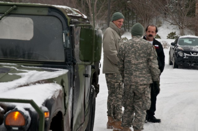 North Carolina National Guard Soldiers Sgt. Colin Kalescky and  Spc. Kevin Thomas, assigned to the 105th Military Police Battalion, Headquarters and Headquarters Company, talk with local first responders outside a medical clinic after transporting a stranded patient in Asheville, N.C., Jan. 23, 2016. The North Carolina National Guard has been working with State Emergency Response partners for the last three days and have 100 Guardsmen mobilized in Eastern, Central and Western North Carolina to support local authorities. (North Carolina National Guard photo by Sgt. Brian Godette, 382nd Public Affairs Detachment)
