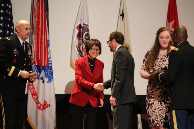 Heidi Shyu, assistant secretary of the Army (Acquisition, Logistics and Technology, congratulates Barry Pike, incoming Program Executive Office for Missiles and Space, following his promotion and swearing in ceremony. Jan. 20, 2016, Redstone Arsenal, Ala.