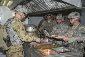 Col. Jeffrey Becker, commander, 3rd Combat Aviation Brigade mans the serving line during 3rd Squadron, 17th Cavalry Regiment's field training exercise on Fort Stewart Jan. 25. (Photo by Spc. Scott Lindblom 3rd CAB Public Affairs)