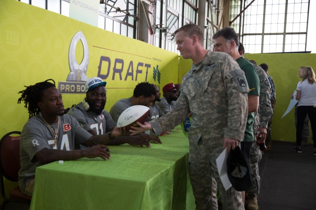 Chief Warrant Officer 2 Westly Turner, Apache Pilot with 229th Attack Reconnaissance Battalion, has his football signed by multiple NFL stars during the 2016 Pro Bowl Draft, Jan. 27.