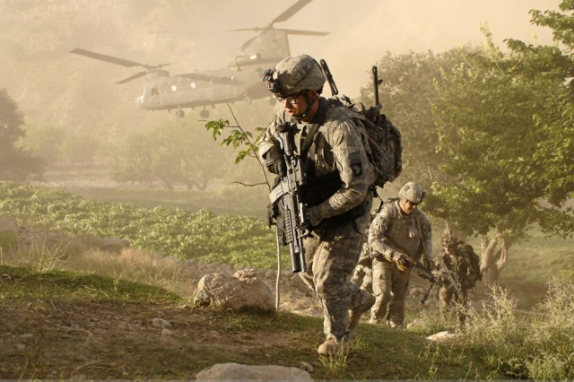 Soldiers from A Company, 101st Division Special Troop Battalion, air assault into a village inside Jowlzak valley, Parwan province, Afghanistan. The National Committee on the Future of the Army said that National Guard and Army Reserve Soldiers must continue to join Regular Army forces in future deployments.