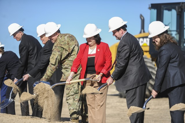 Katherine Hammack (center), assistant Secretary of the Army for Installations, Energy and Environment, along with others, digs up a shovel-full of dirt during the groundbreaking ceremony for a renewable energy project at Fort Hood, Texas, Jan. 28. The project, which will include both solar and wind energy, is the Army's largest project of its kind and is expected to be finished by the end of fiscal year 2016.
