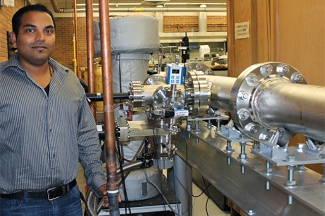 Dr. Subith Vasu stands beside a 50-foot long shock tube used for fuel combustion research at the University of Central Florida.