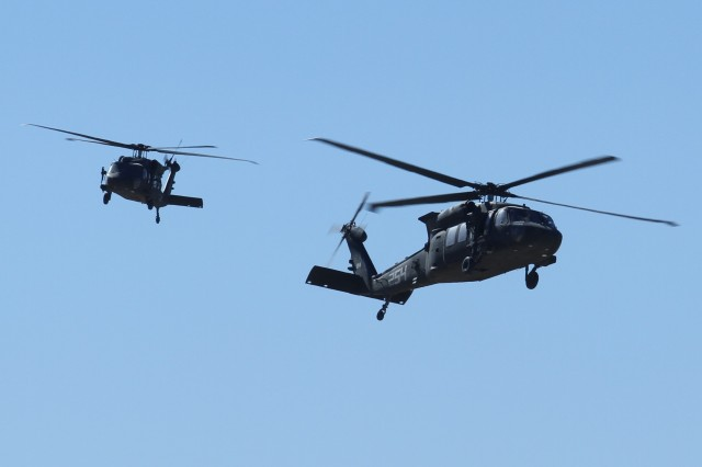 Two U.S. Army UH-60 Black Hawk helicopters assigned to 16th Combat Aviation Brigade fly overhead during decisive action rotation 16-03 at the National Training Center, Calif., Jan. 26, 2016. The Soldiers and aircraft from 16th CAB joined other units from 7th Infantry Division to prepare for future missions.