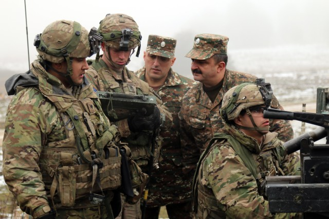 Armenian Maj. Gen. Gennady Tavaratsyan, chief of the strategic planning department of the armed forces, visits with American troops during Exercise Allied Spirit IV at the U.S. Army's Joint Multinational Training Command in Hohenfels Training Area, Germany, Jan. 25, 2016.