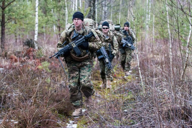 Soldiers, from L Troop, 3rd Squadron, 2nd Cavalry Regiment, move to their next firing position during team leader training in Rukla, Lithuania, Jan. 28, 2016.