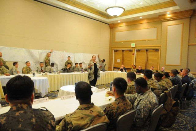 Members of the FY16 Young Alaka'i leader development program complete a free-drawing exercise to reflect their individual leader behaviors and perceptions during a leadership philosophy class, Jan. 12, 2016, at Fort Shafter, Hawaii. The 34 top-performing military leaders from 18 organizations across the Pacific theater embraced the meaning and honor associated with the Hawaiian value of leadership as they gathered on Oahu in January to kick off the FY16 Young Alaka'i class, an in-stride broadening opportunity designed to prepare them to succeed together as tomorrow's strategic leaders. (U.S. Army photo by Sgt. 1st Class Mary E. Ferguson, 8th Theater Sustainment Command Public Affairs/RELEASED)
