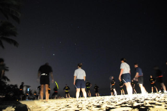 Members of the FY16 Young Alaka'i leader development program beat the sunrise for an intense morning physical training session at Hickam Beach Park on Joint Base Pearl Harbor-Hickam, Jan. 14, 2016. The 34top-performing military leaders from 18 organizations across the Pacific theater embraced the meaning and honor associated with this Hawaiian value of leadership as they gathered on Oahu in January to kick off the FY16 Young Alaka'i class, an in-stride broadening opportunity designed to prepare them to succeed together as tomorrow's strategic leaders. (U.S. Army photo by Sgt. 1st Class Mary E. Ferguson, 8th Theater Sustainment Command Public Affairs/RELEASED)