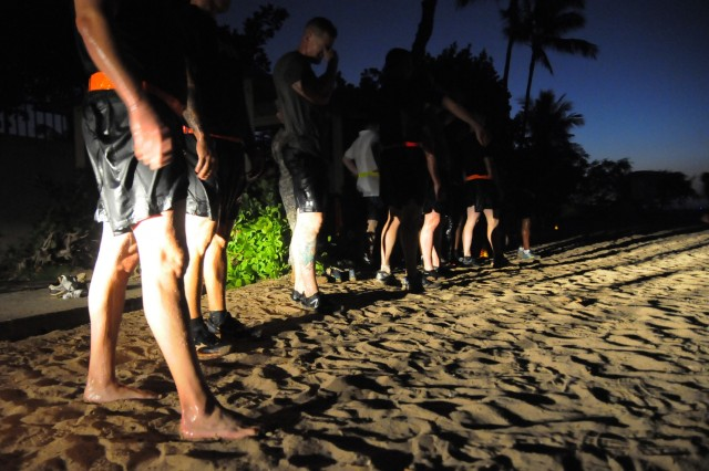 Members of the FY16 Young Alaka'i leader development program beat the sunrise for an intense morning physical training session at Hickam Beach Park on Joint Base Pearl Harbor-Hickam, Jan. 14, 2016. The 34 top-performing military leaders from 18 organizations across the Pacific theater embraced the meaning and honor associated with this Hawaiian value of leadership as they gathered on Oahu in January to kick off the FY16 Young Alaka'i class, an in-stride broadening opportunity designed to prepare them to succeed together as tomorrow's strategic leaders. (U.S. Army photo by Sgt. 1st Class Mary E. Ferguson, 8th Theater Sustainment Command Public Affairs/RELEASED)