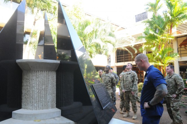 Members of the FY16 Young Alaka'i leader development program spend the final day of the program's first phase on a staff ride together Jan. 16, 2016, visiting historical locations across Oahu, to include the eternal flame memorial at U.S. Pacific Air Forces headquarters on Joint Base Pearl Harbor-Hickam and discussing the strategic implications and role the island has played and continues to play in the region's stability and security. The 34 top-performing military leaders from 18 organizations across the Pacific theater embraced the meaning and honor associated with this Hawaiian value of leadership as they gathered on Oahu in January to kick off the FY16 Young Alaka'i class, an in-stride broadening opportunity designed to prepare them to succeed together as tomorrow's strategic leaders. (U.S. Army photo by Sgt. 1st Class Mary E. Ferguson, 8th Theater Sustainment Command Public Affairs/RELEASED)