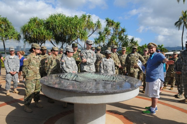 Members of the FY16 Young Alaka'i leader development program spend the final day of the program's first phase on a staff ride together Jan. 16, 2016, visiting historical locations across Oahu, to include the USS Arizona memorial, and discussing the strategic implications and role the island has played and continues to play in the region's stability and security. The 34 top-performing military leaders from 18 organizations across the Pacific theater embraced the meaning and honor associated with this Hawaiian value of leadership as they gathered on Oahu in January to kick off the FY16 Young Alaka'i class, an in-stride broadening opportunity designed to prepare them to succeed together as tomorrow's strategic leaders. (U.S. Army photo by Sgt. 1st Class Mary E. Ferguson, 8th Theater Sustainment Command Public Affairs/RELEASED)