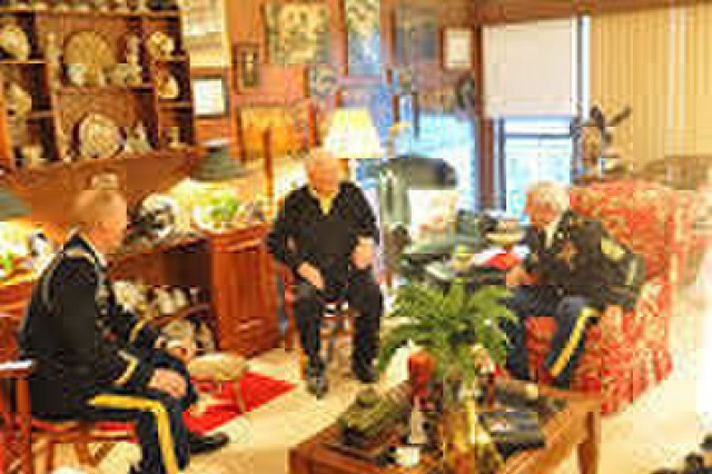 Retired Brig. Gen. Albin Irzyk (center) shares a laugh with Lt. Col. Jason Davis (left), commander, Tiger Squadron, 3rd Cavalry Regiment, and retired Command Sgt. Maj. Harvey Reed, executive director of the 3rd Cav. Association, at Irzyk's home at West Palm Beach, Florida, Jan. 24. Leaders from 3rd CR traveled from Fort Hood, Texas, to visit Irzyk, who served in the regiment in 1940 and recently turned 99 years old. (U.S. Army photo taken by Maj. Vance Trenkel, 3d Cavalry Regiment Public Affairs)