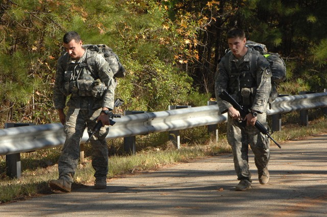 "Soldiers take part in a road march during Ranger assessment at Fort Benning, GA. The ""precision medicine"" approach based on an individual's documented physiological responses could be particularly useful in high-intensity Ranger training where march and run paces are adjusted for environmental conditions. Pacing currently is based on estimates of environmental effects but could be based on individual data in the future. (U.S. Army photo by SGT William E. Henry, Indiana National Guard Public Affairs)"