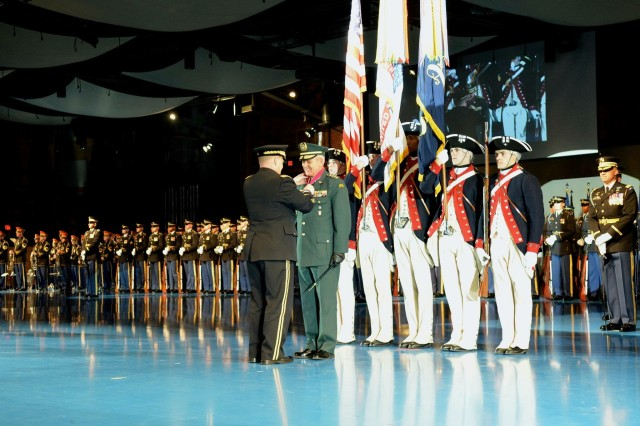 Colombian National Army Commander Gen. Alberto Jose Mejia is awarded the Legion of Merit by U.S. Army Chief of Staff GEN Mark A. Milley during a ceremony at Conmy Hall on Joint Base Myer - Henderson Hall, Tuesday, Feb. 2, 2016. (U.S. Army Photo by Courtney Dock)