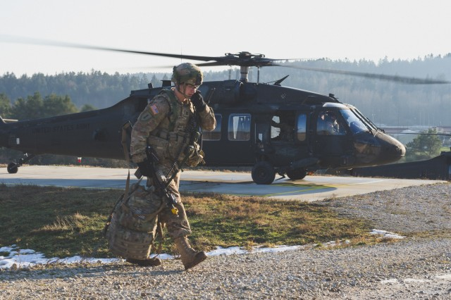 A U.S. Army Soldier from 173rd Airborne Brigade, returns from a successful operation during exercise Allied Spirit IV at the U.S. Army's Joint Multinational Readiness Center in Hohenfels Training Area, Germany, Jan. 26, 2016. An aviation task force made up of elements from 1st Battalion, 3rd Aviation Regiment, 12th Combat Aviation Brigade, Ansbach, and 3rd Battalion, 227th Aviation Regiment, 1st Air Cavalry Brigade, Fort Hood, Texas, provided attack, assault and medical evacuation support to exercise Allied Spirit IV from Jan. 10 - Feb. 5, 2016 at the U.S. Army's Joint Multinational Readiness Center, Hohenfels, Germany.