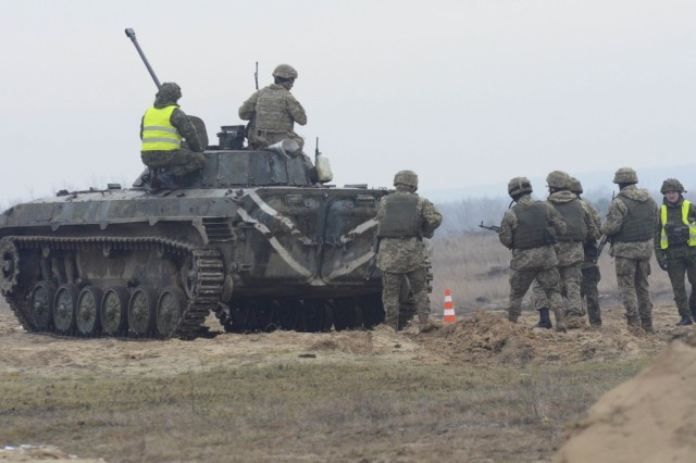 Soldiers with the Ukrainian Army along with paratroopers with the 173rd Airborne Brigade conduct a platoon live-fire exercise Jan. 29, 2016, at the International Peacekeeping Security Center near Yavoriv, Ukraine. The training focuses on defensive combat skills and civil-military operations in conjunction with fundamentals on individual and collective firing as part of Fearless Guardian II. (U.S. Army photo by Staff Sgt. Adriana M. Diaz-Brown, 10th Press Camp Headquarters)