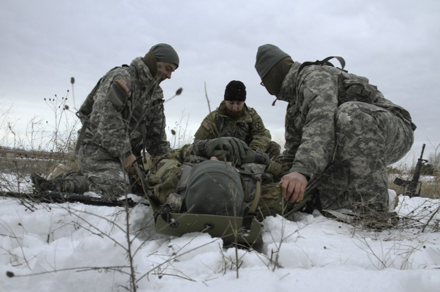 Soldiers, from D Company, 41st Brigade Engineer Battalion, 2nd Brigade Combat Team, transport a simulated casualty using a sked (a kit designed for rapid emergency evacuation of patients) during arctic light individual training on on Fort Drum, N.Y.