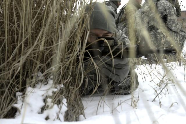 Spc. Dustin Clark, D Company, 41st Brigade Engineer Battalion, 2nd Brigade Combat Team, pulls security during arctic light individual training.