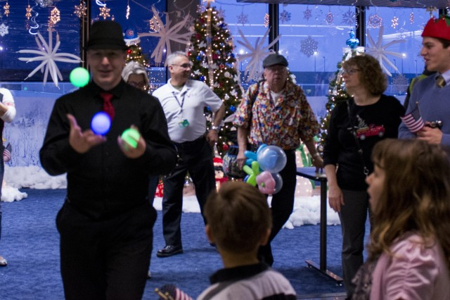 Army Reserve, Navy and Marine Corps members from the greater Chicago area had come to send off the families participating in the Snowball Express, minus the actual snow, Dec. 12. The program is sponsored by American Airlines, coordinating flights from 84 cities via nearly 60 chartered and commercial flights. The Snowball Express is a nonprofit organization established in 2006, providing an all-expenses-paid trip to families across the United States with a mission of bringing hope and new memories to the children of military heroes who have died while on active duty since Sep. 11, 2001.  This year marks the 10th annual celebration, 13 Gold Star families from Northern Illinois were on this flight to Dallas for a weekend getaway of festivities and a memorial service for those family members that have been lost. (U.S. Army photo by Staff Sgt. Carrie A Castillo)