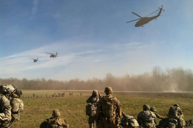 Soldiers, from 1st Battalion, 26th Infantry Regiment, 2nd Brigade Combat Team, 101st Airborne Division (Air Assault), prepare to be picked up UH-60 Black Hawk helicopters before an air assault mission on Fort Knox, Ky., Dec. 9, 2015.