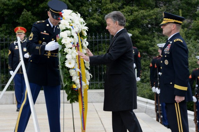 His Excellency Juan Manuel Santos, President of Colombia, lays a wreath at the Tomb of the Unknown Soldier in Arlington National Cemetery during an Armed Forces Full Honors Wreath-Laying Ceremony, Feb. 4, 2016.