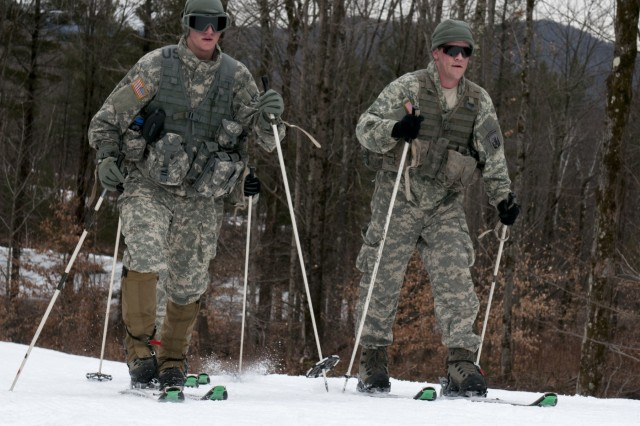 U.S. Soldiers, with Alpha Company, 3rd Battalion, 172nd Infantry Regiment (Mountain), Vermont National Guard, cross-country ski at Camp Ethan Allen Training Site in Jericho, Vt., Feb. 6, 2016.