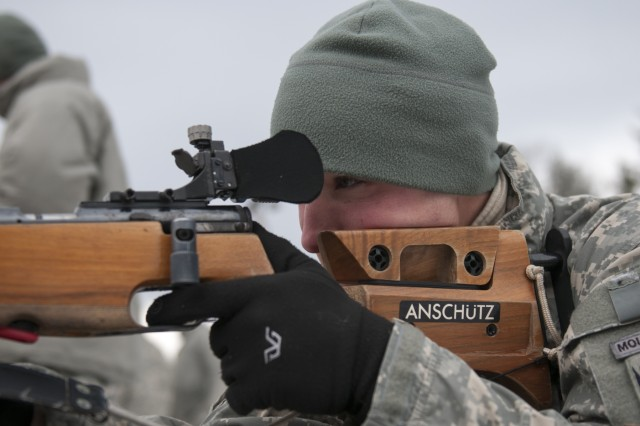 A U.S. Soldier, with Alpha Company, 3rd Battalion, 172nd Infantry Regiment (Mountain), Vermont National Guard, conducts a live-fire exercise with a .22-caliber rifle at Camp Ethan Allen Training Site in Jericho, Vt., Feb. 6, 2016.