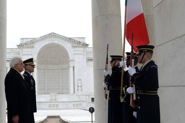 His Excellency Sergio Mattarella, President of the Italian Republic, and Maj. Gen. Bradley A. Becker, U.S. Army Military District of Washington commanding general, render honors to the Italian flag during an Armed Forces Full Honors Wreath-Laying Ceremony at the Tomb of the Unknown Soldier at Arlington National Cemetery, Va., Feb. 7, 2016.