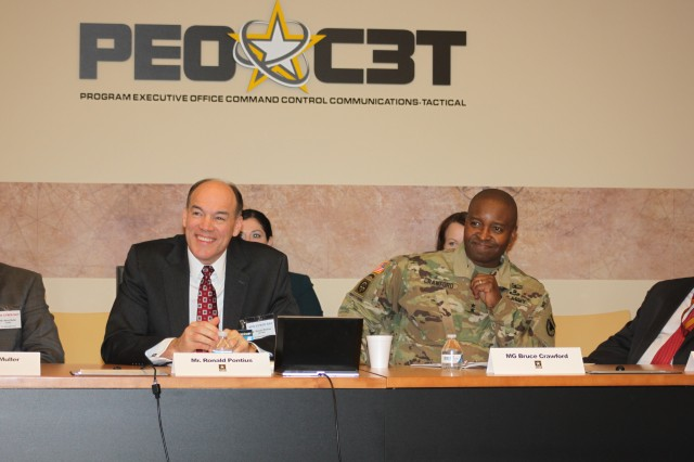 Ron Pontius, deputy to the commanding general, U.S. Army Cyber Command, and APG Senior Commander Maj. Gen. Bruce T. Crawford share a laugh during introductions at the Team APG Cyber Day, Jan. 27.