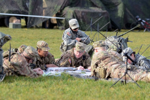 U.S. Army Lt. Col. Eric Baus, center, deputy commander of 173rd Airborne Brigade, discusses a plan of action during the brigade's week-long training event, Allied Spirit IV Command Post Exercise, Feb. 8, 2016.