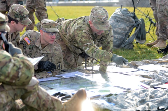 U.S. Army Col. Gregory Anderson, center, commander, 173rd Airborne Brigade, briefs a plan of action during the brigade's week-long training event, Allied Spirit IV Command Post Exercise, Feb. 8, 2016.