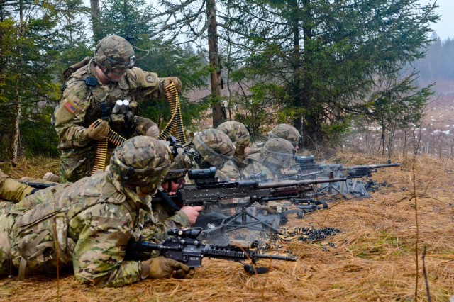 Soldiers, of 3rd Squadron (Wolfpack), 2nd Cavalry Regiment, reload and fire during a squad live-fire exercise on Tapa Training Area in Tapa, Estonia, Feb. 3, 2016.