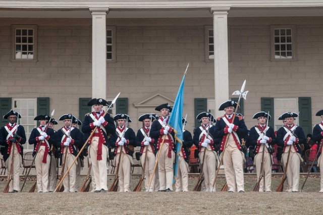 Soldiers from the 3d U.S. Infantry Regiment (The Old Guard) perform during a by patriotic music and a military firing demonstration at Mount Vernon, Va., Feb. 16, 2015.