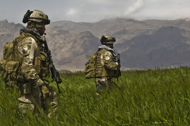 """U.S. Special Operations Command uses cognitive testing to determine if Soldiers have """"grit"""" and determination to succeed. The testing also can reveal hidden personality disorders that could impact performance. Shown here are Special Forces Soldiers, from the 3rd Special Forces Group, patrolling a field in the Gulistan district of Farah, Afghanistan, with Afghan National Army commandos from the 207th Kandak."""