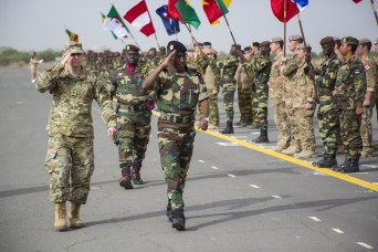 Brig. Gen. Donald  C. Bolduc, Special Operations Command Africa commander, inspects troops with his Senegalese counterpart Senegalese Brig. Gen. Amadou Kane in Thies, Senegal, Feb. 8, 2016. More than 1,700 participants from over 30 nations spanning from Africa, Europe and North America took part the annual Flintlock exercise.
