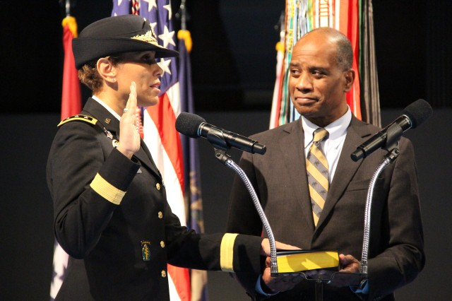 Lt. Gen. Nadja West repeats the Oath of Office following her promotion to three-star. West's husband Army Col. (Ret.) Donald West holds the Bible, Feb. 9, 2016. Photo by Brandon Marrone.