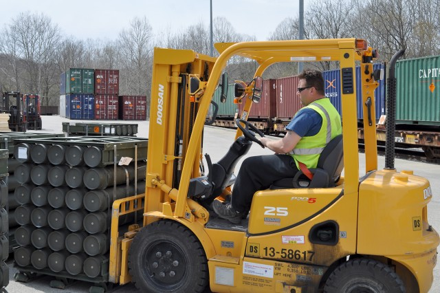 A forklift operator transports a pallet of ammunition at Crane Army Ammunition Activity (CAAA), Indiana. The CAAA's mission is to receive, store, and ship conventional ammunition and munitions in support of worldwide military operations.