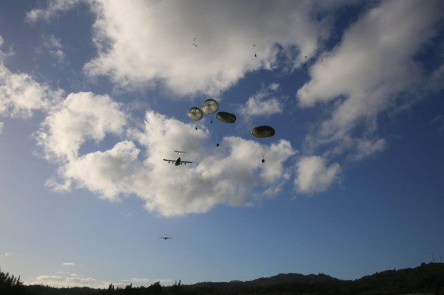 A U.S. Air Force C-17 releases supply loads above Kahuku Training Area Feb. 8, 2016.