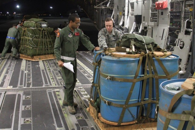 U.S. Air Force Air Transportation Specialists with the 647th Logistics Readiness Squadron/Combat Mobility Flight, load CDS bundles onto a C-17 at Joint Base Pearl Harbor-Hickam in preparation for an aerial drop into the Kahuku Training Area, Feb. 8. The drop was part of a joint exercise with the 25th Sustainment Brigade and 2nd Brigade Combat Team for the 25th Infantry Division Lightning Forge exercise. (Photo by Sgt. 1st Class Sean Riley, 25th Sustainment Brigade PAO)