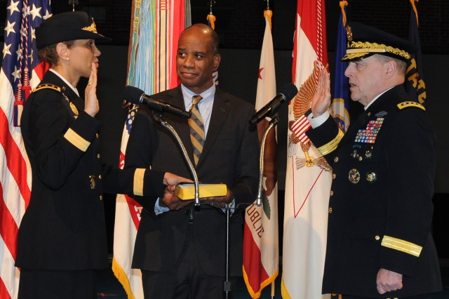 Army Chief of Staff Gen. Mark A. Milley formally swears in Lt. Gen. Nadja Y. West as 44th Army surgeon general as her husband, Don, holds the Bible on Joint Base Myer-Henderson Hall, Va., Feb. 9, 2016.