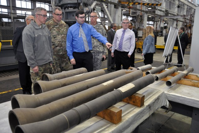 Lt. Gen. Thomas W. Spoehr, left, being briefed on a flow form mortar process by Arsenal Foreman Scott Huber, in blue shirt.