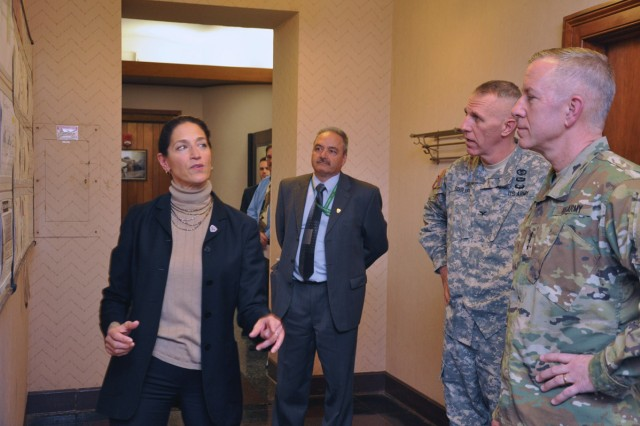 Karen Heiser, the Arsenal's chief of the continuous improvement program, briefing Lt. Gen. Thomas W. Spoehr, right, on the Arsenal's Transformation Plan of Care program.  Arsenal Commander Col. Lee H. Schiller Jr. and Deputy Commander Joe Turcotte listen in.