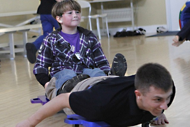 "Big Brothers and Big Sisters gathered with their younger friends, the ""Littles,"" last year at West Point's Lee Child Development Center. The Cadets and their ""Littles"" made use of the facility's gymnasium, riding the inflatables, trying out the basketball nets, hula hoops and jump ropes and other recreational activities (U.S. Army photo by Mike Strasser, USMA West Point Pointer View/released.)"