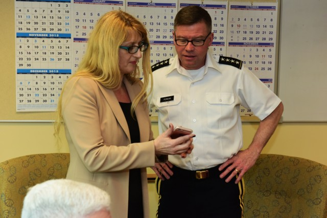 Dr. Branka Sarac, director of technology integration at the Defense Language Institute Foreign Language Center, shows Gen. David Perkins, commanding general of U.S. Army Training and Doctrine Command, a language-learning app developed by the institute Feb. 9.