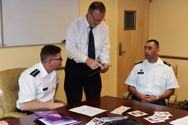 Dr. Tamas Marius, director of language technology evaluation and assessment at the Defense Language Institute Foreign Language Center, shows Gen. David Perkins, commanding general of U.S. Army Training and Doctrine Command, a language-learning app developed by the institute Feb. 9. Command Sgt. Maj. Matildo Coppi, the institute's command sergeant major, looks on.
