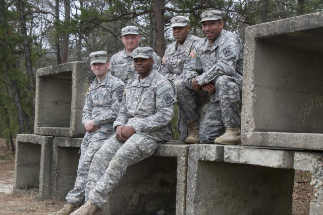 Army Reserve Soldiers assigned to the Cumberland, Maryland-based 372nd Military Police Company (from left to right), Sgt. Jonah Rock, an MP from Hagerstown, Md.; Sgt. Sean McCarthy, a signal support systems specialist, from Martinsburg, W. Va.; Cpl. Aaron Dabney, an internment and resettlement specialist from Alexandria, Va.; Sgt. Regginald Brown, an MP from Clifton, N.J.; and Sgt. Eric Blake, an MP from Aberdeen, Md.; pose for a picture during battle assembly Jan. 9, 2016, at Joint Base McGuire-Dix-Lakehurst, N.J. The Soldiers, along with Sgt. Kori Leopoldo, apprehended a robbery suspect Dec. 12 after leaving a CVS in Pemberton Township, N.J., during their annual training at JBMDL. (U.S. Army Reserve photo by Sgt. 1st Class Jacob Boyer/Released)