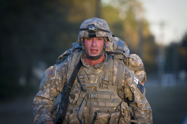 Sgt. John Bullough, from Baltimore, assigned to the 400th Military Police Battalion, powers through a ruck march during this year's 200th Military Police Command Best Warrior Competition at Camp Blanding, Fla., Feb. 10. The winning noncommissioned officer and junior enlisted Soldiers will move on to the U.S. Army Reserve Command competition in May. (U.S. Army Photo by Sgt. Audrey Ann Hayes)