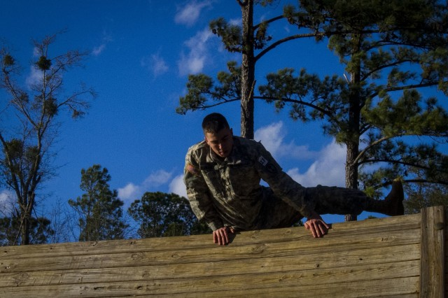 Spc. Alexander Cranick, with the 384th Military Police Battalion, from Springfield, Ill., clears a wall during an obstacle course at this year's 200th Military Police Command Best Warrior Competition held at Camp Blanding, Fla., Feb. 9. The winning noncommissioned officer and junior enlisted Soldiers will move on to the U.S. Army Reserve Command competition in May. (U.S. Army Photo by Sgt. Audrey Ann Hayes)
